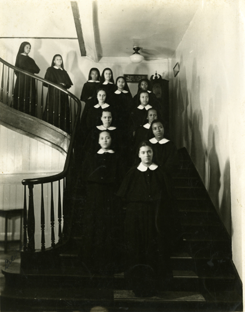 Band of Postulants on Circular Stairway